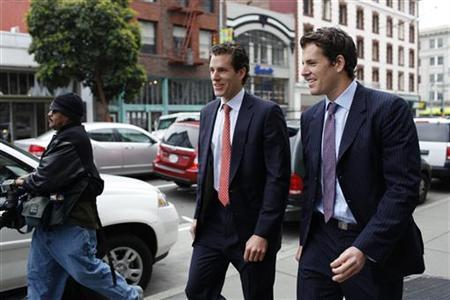 Cameron Winklevoss (L) and brother Tyler Winklevoss leave the 9th Circuit Court of Appeals after a hearing on a settlement dispute with Facebook's Mark Zuckerberg in San Francisco, California January 11, 2011. REUTERS/Stephen Lam
