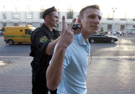 A Belarussian policeman detains a man in central Minsk, June 22, 2011. REUTERS/Julia Darashkevich