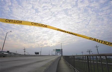 A caution tape floats in the wind over a walkway running alongside the Danziger Bridge in eastern New Orleans, November 10, 2005. REUTERS/Lucas Jackson