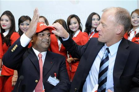 Airbus Chief Executive Officer Tom Enders (R) and Founder of AirAsia X Tony Fernandes pose for photographers during an announcement at the 49th Paris Air Show at the Le Bourget airport near Paris June 23, 2011. REUTERS/Gonzalo Fuentes