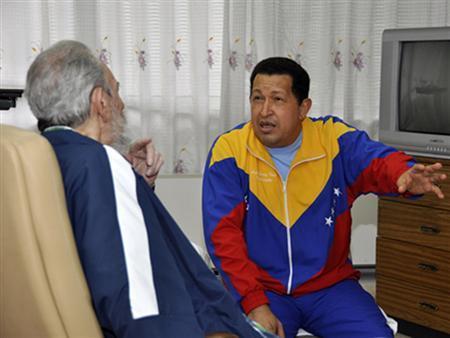 Venezuela's President Hugo Chavez (R) is visited by Cuba's revolutionary leader Fidel Castro at a hospital in Havana in this June 17, 2011 handout file photo. REUTERS/Revolution Studios/Cubadebate/Handout/Files