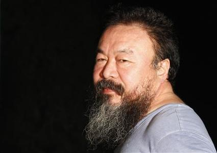 Dissident Chinese artist Ai Weiwei stands in the entrance of his studio after being released on bail in Beijing June 23, 2011. REUTERS/David Gray