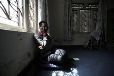 <p>Raju Baral, 27, who is HIV positive, speaks on the phone in the Care Support and Treatment Center run by Blue Diamond Society in Kathmandu June 23, 2011. REUTERS/Navesh Chitrakar</p>