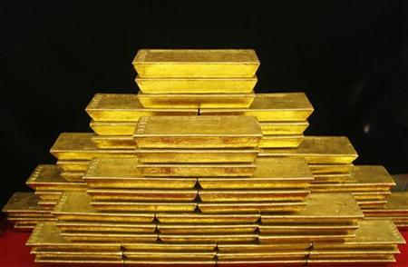 Gold bars are seen in this picture illustration taken at the Czech National Bank in Prague January 31, 2011. REUTERS/Petr Josek