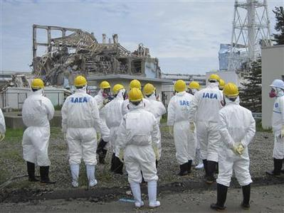 International Atomic Energy Agency (IAEA) inspection team members look at the No.3 reactor at the crippled Tokyo Electric Power Co. Fukushima Daiichi nuclear power plant in Fukushima Prefecture, in this handout photo taken and released by TEPCO on May 27, 2011. REUTERS/Tokyo Electric Power Co/Handout/Files