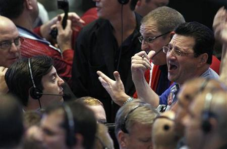 Traders in the 10-year bond options pit signal orders at the Chicago Board of Trade September 21, 2010. REUTERS/Frank Polich
