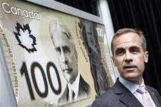 <p>Bank of Canada Governor Mark Carney takes part in the unveiling of new $50 and $100 polymer bank notes at the Bank of Canada in Ottawa June 20, 2011. REUTERS/Blair Gable</p>
