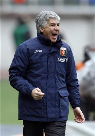 In this file picture, Genoa's coach Giampiero Gasperini reacts during their Italian Serie A match against AS Roma at the Olympic stadium in Rome January 17, 2010. REUTERS/Giampiero Sposito