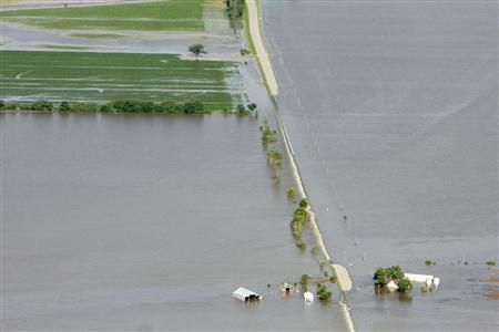 An aerial view of a farm north of Council Bluffs, Iowa, submerged in Missouri River flood waters June 24, 2011. The Missouri River, swollen by heavy rains and melting snow, has been flooding areas from Montana through Missouri. REUTERS/Lane Hickenbottom