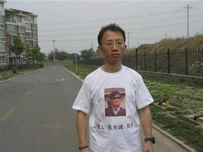 One of China's most prominent dissidents, Hu Jia, wears a shirt in support of blind Chinese lawyer Chen Guangcheng, in this undated handout. The words on the T-shirt read: ''Blindman, Chen Guangcheng, Freedom''. REUTERS/Handout