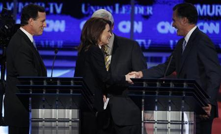 Republican presidential hopefuls former U.S. Senator Rick Santorum (R-PA) (L), U.S. Rep. Michele Bachmann (R-MN), former Speaker of the U.S. House of Representatives Newt Gingrich (R-GA) and former Massachusetts Governor Mitt Romney (R), shake hands at the end of the first New Hampshire debate of the 2012 campaign at St. Anselms College in Manchester, New Hampshire June 13, 2011. REUTERS/Shannon Stapleton