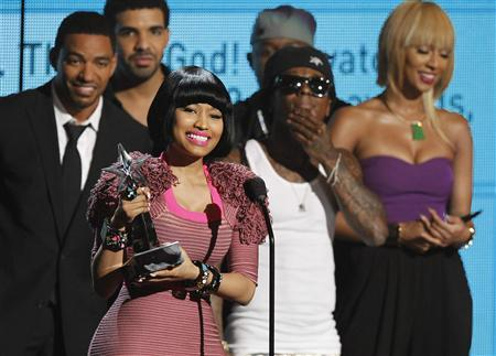 Nicki Minaj accepts best female hip hop artist award at the 2011 BET Awards in Los Angeles June 26, 2011. REUTERS/Mario Anzuoni