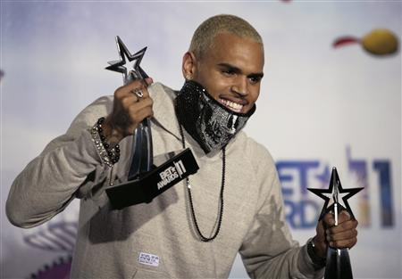 Singer Chris Brown poses for photographers with two of the four BET Award he won at the 2011 BET Awards in Los Angeles, California, June 26, 2011. REUTERS/Jason Redmond