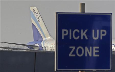 An IndiGo aircraft stands on tarmac at the airport in New Delhi January 12, 2011. REUTERS/Adnan Abidi