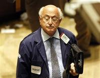 <p>A trader pauses to close his eyes as he works on the floor of the New York Stock Exchange in the final minutes of the trading session in New York, October 9, 2008. REUTERS/Mike Segar</p>