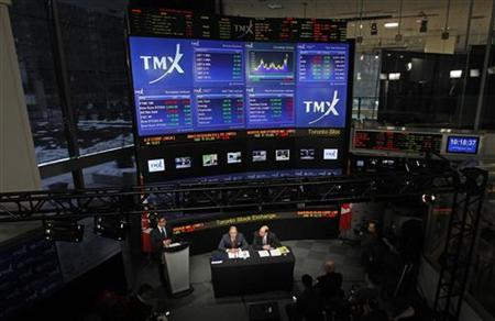 London Stock Exchange CEO Xavier Rolet (L) and TMX Group CEO Tom Kloet speak to the media in an overall view of the TMX Broadcast centre regarding the merger of the TSX and the LSE in Toronto, February 9, 2011. REUTERS/Mark Blinch