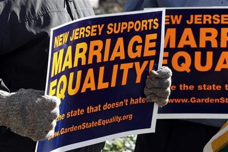 Supporters of gay marriage hold placards before hearing the New Jersey Supreme court decision on same-sex marriage in front of the Supreme court building in Trenton, New Jersey, October 25, 2006. REUTERS/Tim Shaffer