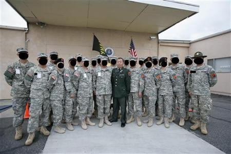 Yupeng Deng (C) poses with his troops in an undated photo. REUTERS/FBI/DCIS