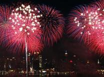 <p>Fireworks explode over the New York City skyline as part of the Independence Day celebration in New York, July 4, 2010. REUTERS/Jessica Rinaldi</p>