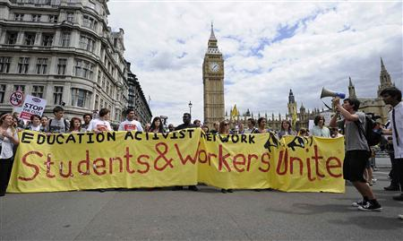 Demonstrators march past the Houses of Parliament during a protest over pension reforms in London June 30, 2011. REUTERS/Paul Hackett