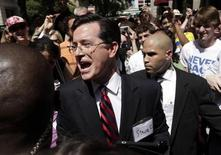 <p>Stephen Colbert greets a crowd outside the Federal Election Commission (FEC) after his meeting with members of FEC to discuss his proposal to establish an Independent expenditure-only political committee and Draft Advisory Opinion 2011-12 in Washington June 30, 2011. REUTERS/Yuri Gripas</p>