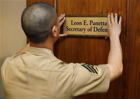U.S. Marine Sgt. John Kang mounts the nameplate of incoming Secretary of Defense Leon Panetta onto his office door at the Pentagon, July 1, 2011. REUTERS/Larry Downing