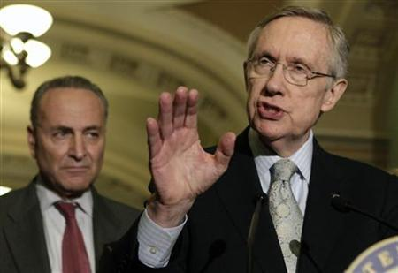 Senate Majority Leader Harry Reid (D-NV) speaks to the media on U.S. budget talks next to Sen. Charles Schumer (D-NY) on Capitol Hill in Washington June 23, 2011.  REUTERS/Yuri Gripas