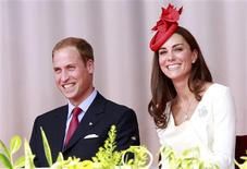 <p>Britain's Prince William and his wife Catherine, Duchess of Cambridge, react during Canada Day celebrations on Parliament Hill in Ottawa July 1, 2011. REUTERS/Chris Wattie</p>