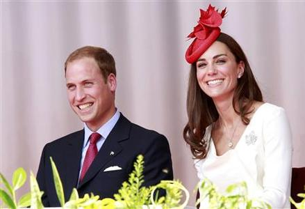 Britain's Prince William and his wife Catherine, Duchess of Cambridge, react during Canada Day celebrations on Parliament Hill in Ottawa July 1, 2011. REUTERS/Chris Wattie