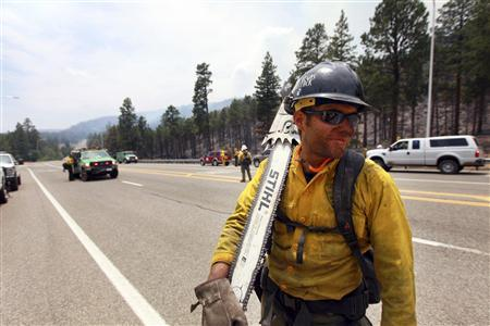 A fire crew member is seen as fire crews are deployed in order to attack hotspots from the Las Conchas wildfire near Los Alamos, New Mexico June 30, 2011. REUTERS/Eric Draper