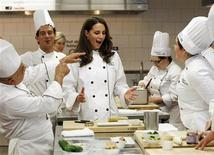 <p>Catherine, Duchess of Cambridge, reacts during a cooking workshop at the Institut de tourisme et d'hotellerie du Quebec in Montreal July 2, 2011. Prince William and his wife Catherine are on a royal tour of Canada from June 30 to July 8. REUTERS/Mathieu Belanger</p>