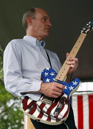 Rep Thaddeus McCotter (R-Mich) plays his guitar with a band after formally announcing his bid for the 2012 U.S presidential race at a ''Freedom Festival'' in Whitmore Lake, Michigan July 2, 2011. REUTERS/Rebecca Cook