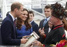 <p>Britain's Prince William and his wife Catherine, Duchess of Cambridge, speak to Huron-Wendat Grand Chief Konrad Sioui in Quebec City July 3, 2011. REUTERS/Christinne Muschi</p>