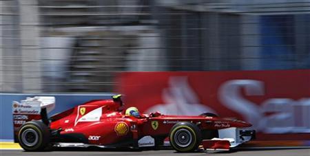 Ferrari Formula One driver Felipe Massa of Brazil takes a curve during the qualifying session of European F1 Grand Prix in Valencia June 25, 2011. REUTERS/Francisco Bonilla