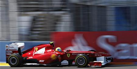 Ferrari Formula One driver Felipe Massa of Brazil takes a curve during the qualifying session of European F1 Grand Prix in Valencia June 25, 2011. REUTERS/Francisco Bonilla