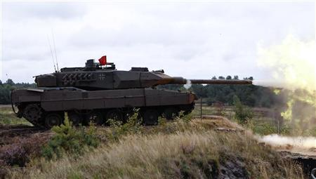 A German Bundeswehr armed forces Leopard 2 tank of the 62th mechanized infantry battalion fires a shell during a military exercise in the northern German town of Bergen, some 80 km (49.7 miles) south of Hamburg, September 1, 2010. REUTERS/Fabrizio Bensch
