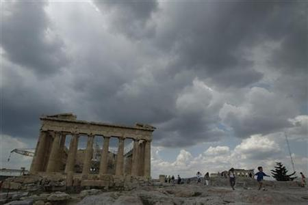 Tourists walk around the temple of the Parthenon at the archaeological site of the Acropolis hill in Athens June 16, 2011. REUTERS/Yiorgos Karahalis