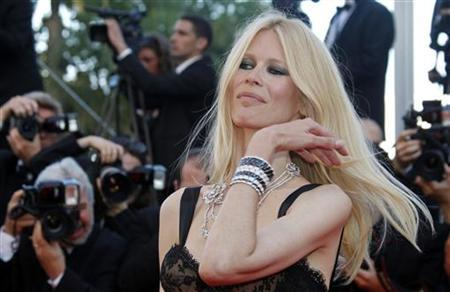 Model Claudia Schiffer arrives on the red carpet for the screening of the film ''This Must Be The Place'', in competition at the 64th Cannes Film Festival May 20, 2011. REUTERS/Jean-Paul Pelissier