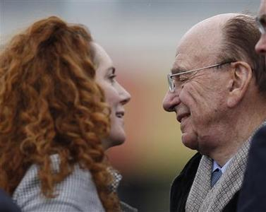 Rebekah Brooks, chief executive of News International and Rupert Murdoch, News Corp chief executive at The Cheltenham Festival horse racing meet in Gloucestershire, March 18, 2010. REUTERS/Eddie Keogh