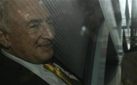Former International Monetary Fund (IMF) chief Dominique Strauss-Kahn is seen smiling through a car window as he departs his lawyer's office in New York July 6, 2011. REUTERS/Brendan McDermid