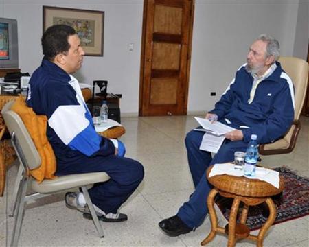 A handout photo shows former Cuban leader Fidel Castro (R) and Venezuela's President Hugo Chavez speaking during a meeting in Havana July 3, 2011. REUTERS/Revolution Studios/Cubadebate/Handout