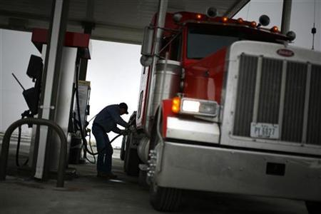 Truck driver Randy Walker fills his rig's tanks with biodiesel fuel at a gas station in the town of Nevada, Iowa, December 6, 2007. REUTERS/Jason Reed