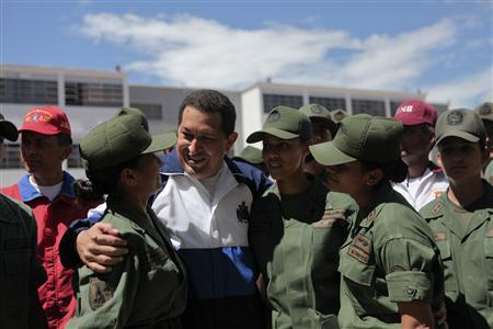 Venezuela's President Hugo Chavez (C) talks to soldiers as he attends a ceremony at the military academy in Caracas July 7, 2011. REUTERS/Miraflores Palace/Handout