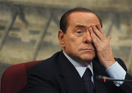 Italian Prime Minister Silvio Berlusconi gestures during a presentation of a book by Italian member of Parliament Domenico Scilipoti at Montecitorio Palace in Rome July 7, 2011. REUTERS/Stringer