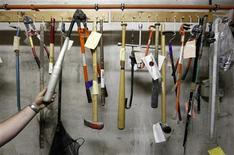<p>Baseball bats, crowbars and hammers are some of the pieces of evidence stored in the basement of the Brussels palace of justice, July 7, 2011. REUTERS/Yves Herman</p>