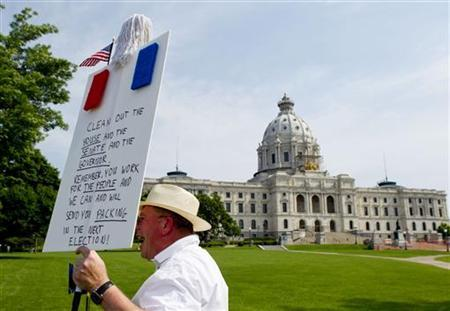 Erik Meade protests in front of the closed Minnesota State Capital in Saint Paul, Minnesota, Friday July 1, 2011. REUTERS/Andy King
