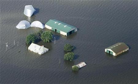 An aerial view of a farm north of Council Bluffs, Iowa, submerged in Missouri River flood waters June 24, 2011. REUTERS/Lane Hickenbottom