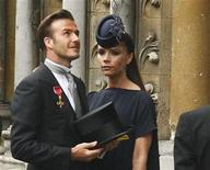 <p>Soccer star David Beckham and his wife Victoria arrive at Westminster Abbey before the wedding of Britain's Prince William and Kate Middleton, in central London April 29, 2011. REUTERS/Kai Pfaffenbach</p>