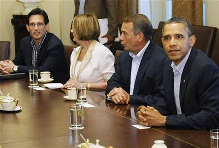 U.S. President Barack Obama (R) sits down to a meeting with House Speaker John Boehner (R-OH) (2nd R), House Minority Leader Nancy Pelosi (D-CA) (2nd L), House Majority Leader Eric Cantor (R-VA) (L) and other congressional leaders for talks aimed at averting a looming U.S. debt default, in the cabinet room at the White House in Washington, July 10, 2011. REUTERS/Jonathan Ernst