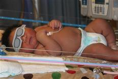<p>JaMichael Brown was born weighing 16 pounds, 1 ounce, to Janet Johnson and Michael Brown at the Good Shepherd Medical Center in Longview, Texas, on July 8, 2011. REUTERS/Good Shepherd Medical Center</p>
